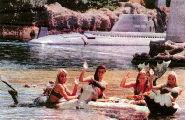 `67 women in mermaid
